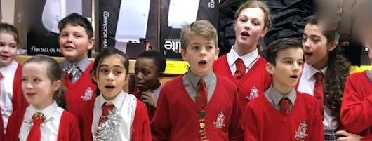 The Froebelian Choir Performs in Local Supermarket for Charity